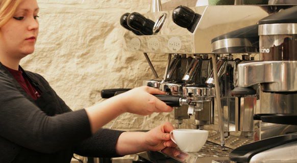 Photograph of a barista making coffee at St Giles' Cathedral Café